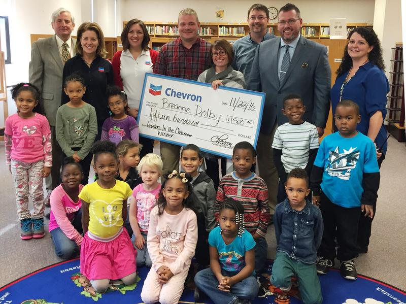 Duquesne Elementary Kindergarten teacher Breanne Dolby poses with representatives from Chevron, the school district and her own classroom after receiving one of the 2016 Leaders in the Classroom awards.