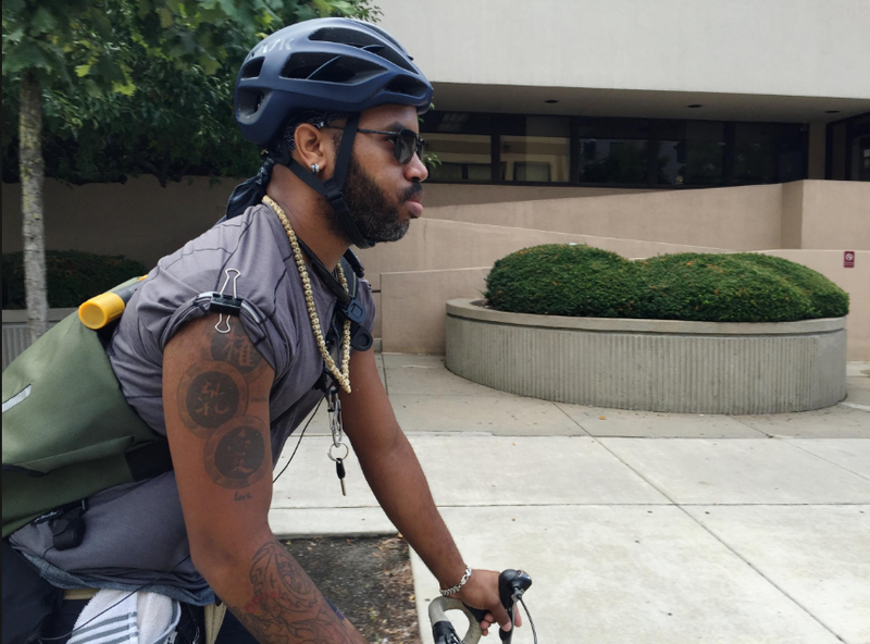 Bike messenger Nic Woods, 30, of Wilkinsburg, rides Downtown through the Strip District to pick up a package. He's been a messenger in the city for 2.5 years.