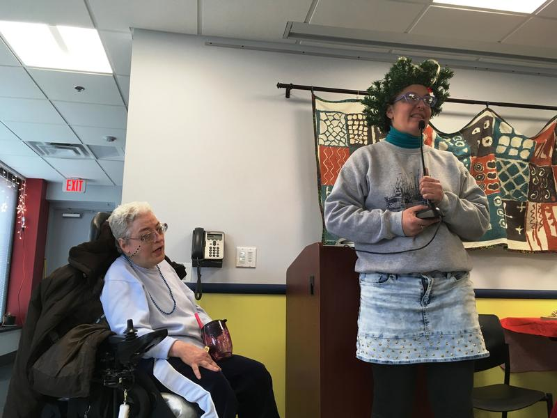 """Teresa Martuccio (right) and Sherry Johnson prepare to sing """"Leaving on a Jet Plane"""" at Martuccio's going away party on Wednesday, December 21, 2016."""