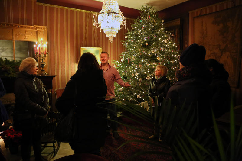 Mark Moore, 47, shows off high Victorian interiors at 937 Beech Avenue during a holiday home tour in Pittsburgh's Allegheny West. Now a father of two, he frets every time his teen sons wag basketballs or hockey pucks around the 125-year-old space.