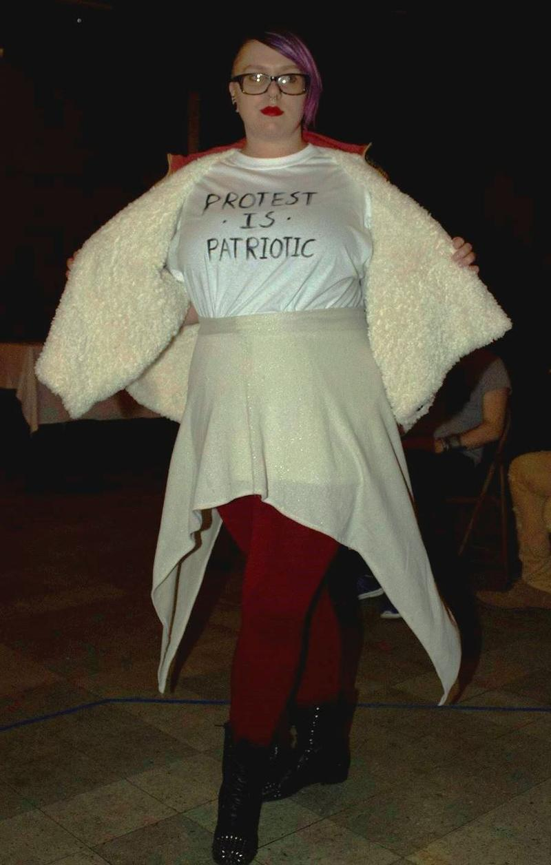 """Hannah Waechter, 26, models an outfit by Jeremy Priola with a """"Protest is Patriotic"""" shirt on Thursday, Jan. 19, 2017."""