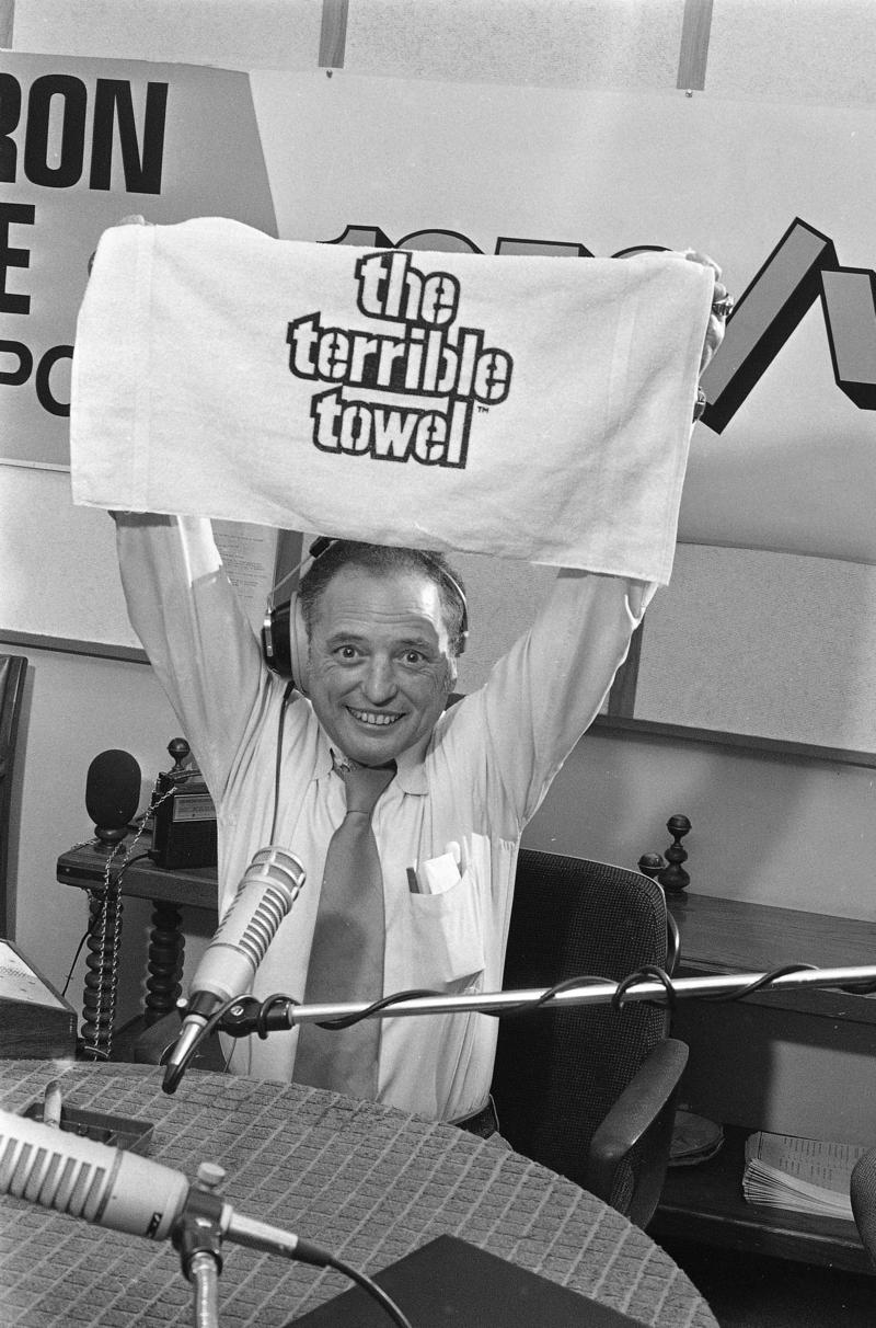 Pittsburgh sportcaster Myron Cope shows a Terrible Towel, a Cope brainchild that became a marketing success in Pittsburgh through the 1970s. The towel was supposed to give the team supernatural powers leading up the AFC playoff game against Miami in 1979.