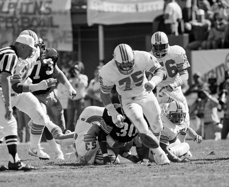 Miami Dolphin end Doug Betters (75) chases a loose ball by the Pittsburgh Steelers in the first half of the AFC Championship in Miami on Sunday, Jan. 6, 1985. The Dolphins recovered the ball and went on to win 45-28.