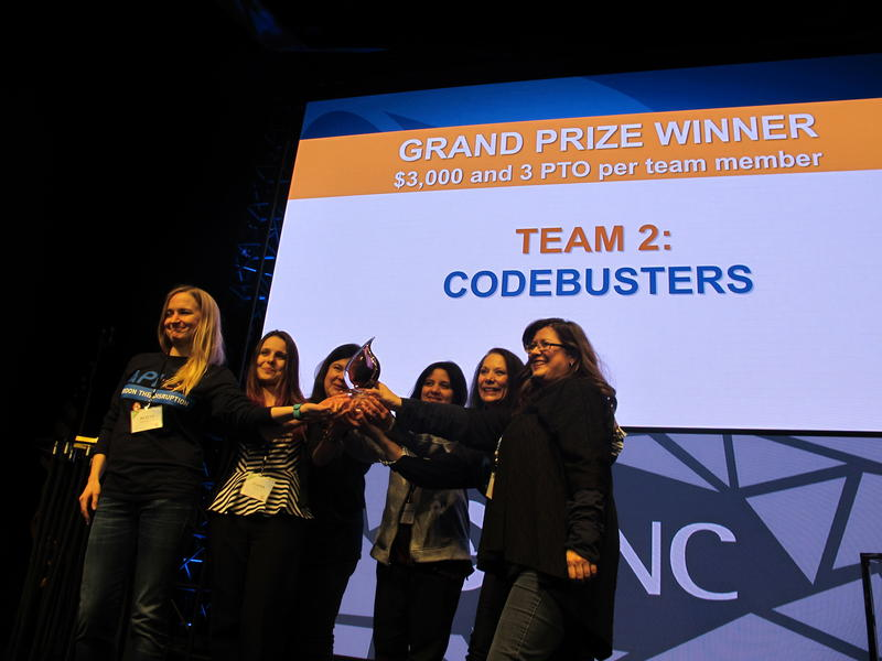 "Members of the team ""Codebusters"" accept their prizes for winning PNC's 24-hour hack-a-thon. Each team member got $3,000 and three extra vacation days."