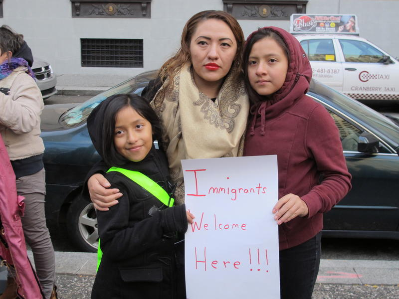 The wife and children of Pittsburgh activist Martin Esquivel-Hernandez pictured at a rally in Downtown Pittsburgh calling for the city to become a sanctuary city.