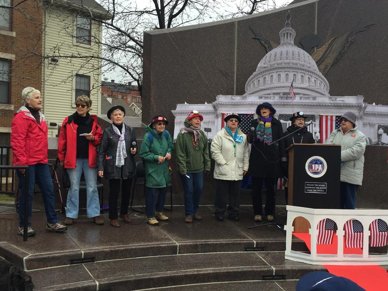 The 'Raging Grannies' sing to the crowd about peace and inclusivity at the People's Inauguration event in the Hill District on Friday, Jan. 20, 2017.