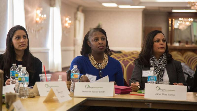 Women run: Natascha Taylor-Smith from Montgomery County (center) listens to Anne Wakabayashi, the executive director of EmergePA. EmergePA is a democratic organization designed to prepare women who want to run for public office.