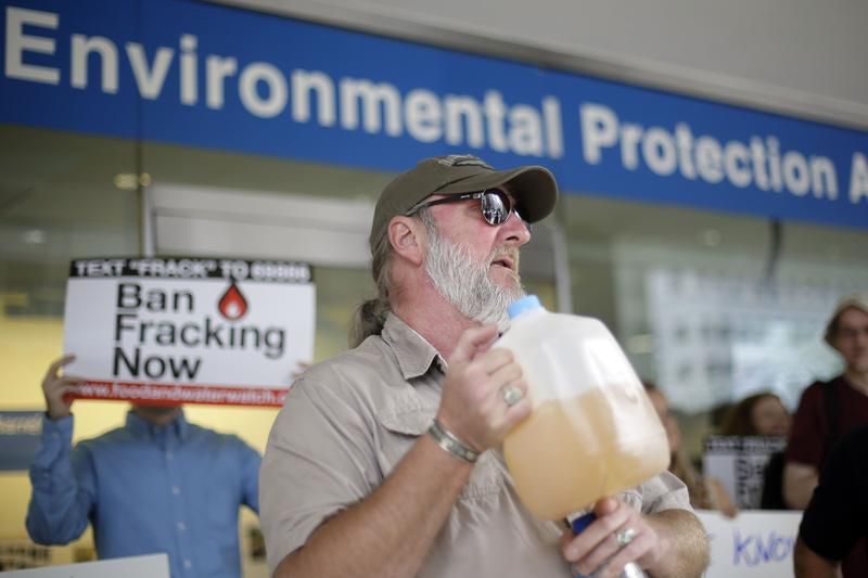 Ray Kemble of Dimock, Pennsylvania holds up a jug of what he identifies as his contaminated well water as he speaks at a demonstration opposed to hydraulic fracturing, outside a regional office of the U.S. Environmental Protection Agency Aug. 12, 2013.