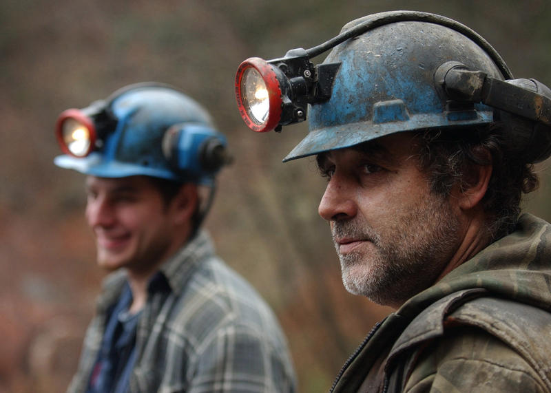 Kenny Rothermel, right, takes a break from working in the Snyder family's Rattling Run Coal company anthracite mine. CNX Coal Resources says it's laying off 200 miners locally because of an environmental ruling protecting Kent Run in Greene County.