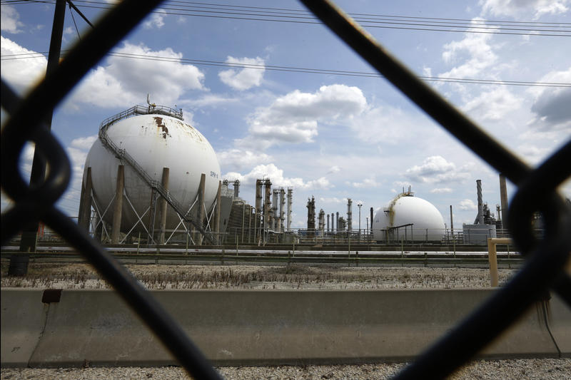 The Marcus Hook Refinery is visible through a fence, Wednesday, July 11, 2012, in Marcus Hook, Pa.