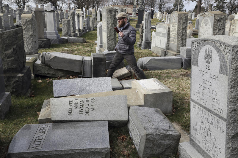 Rabbi Joshua Bolton of the University of Pennsylvania's Hillel center surveys damaged headstones at Mt. Carmel Cemetery on Monday, Feb. 27, 2017, in Philadelphia.