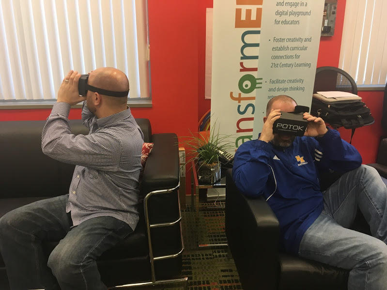 Doug Kirchner, social studies teacher at Upper St. Clair High School, and Casey Phillips, geography teacher at Brentwood Middle School, experience virtual reality as part of a training presented by the Allegheny Intermediate Unit on February 10, 2017.