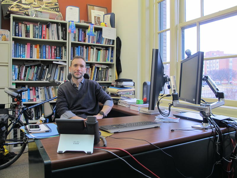 Alessandro Acquisti sits in his CMU office from which he will run the Risk and Regulatory Services Innovation Center.
