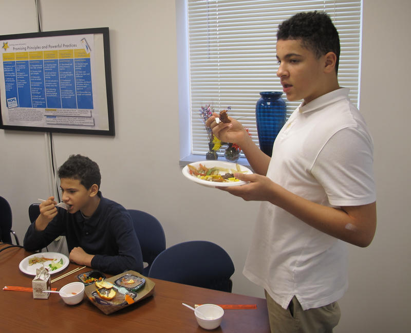 Propel Montour student Darius Wade gives his opinion on Cambodian fish cakes, while Kaden Pennix sits nearby as part of the school's Taste the World program.