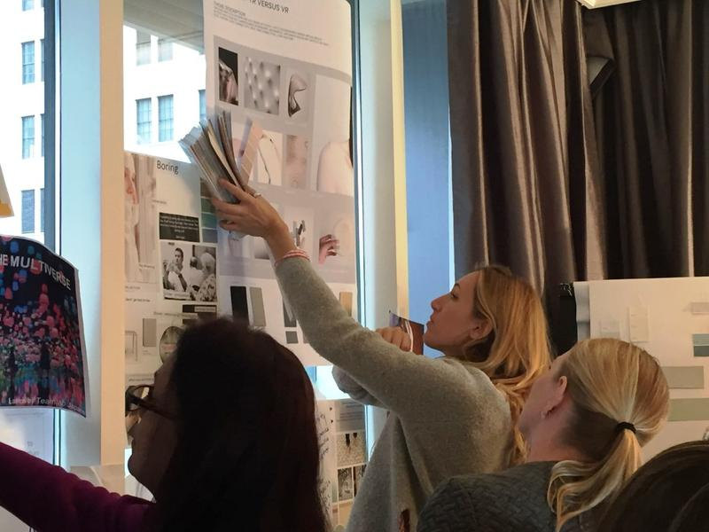 Color stylists compare swatches to glossy images hung on the walls of the Hotel Monaco in downtown Pittsburgh on Wednesday, Feb. 1, 2017.