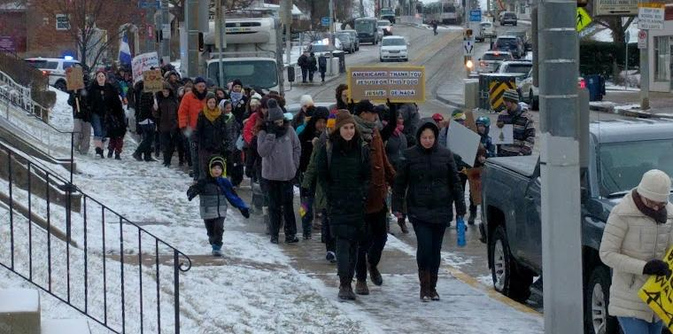 Protestors in Beechview march alongside Broadway Avenue as part of Pittsburgh's 'Day Without Immigrants' on Thursday, Feb. 16, 2017. The rally was in protest of President Donald Trump's immigration agenda.