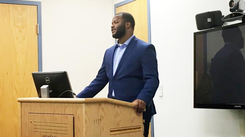 """Penn State junior Brian Davis addresses a small group of people who have """"borrowed"""" him from the human library."""