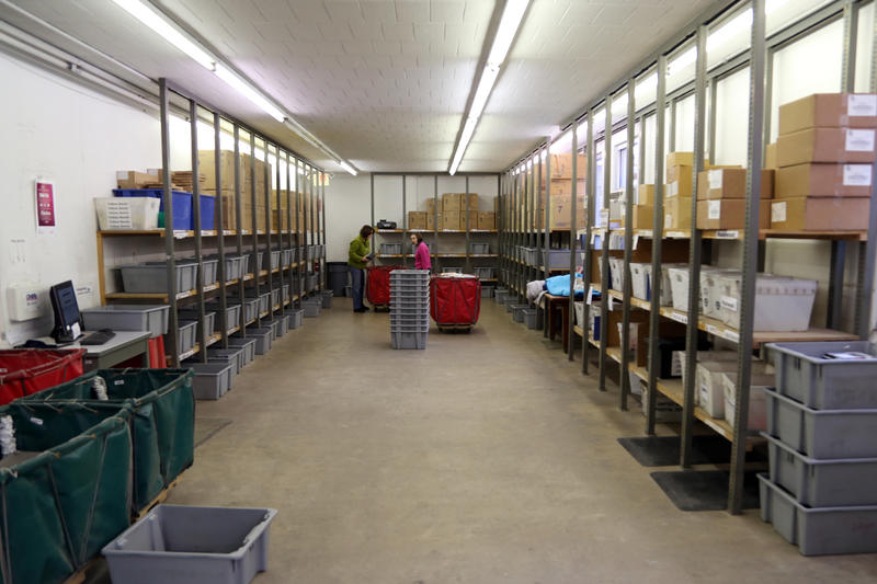 Hundreds of boxes are loaded in and out of the Carnegie Library of Pittsburgh's West End warehouse where sorters -- human and machine -- ready about 13,000 books a weekday for distribution across Allegheny County.