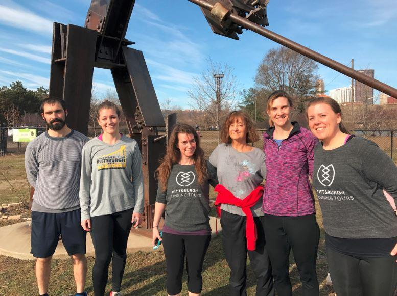 Trista Yerks, right, poses with members of one of her Saturday running tours on the South Side on Saturday, Feb. 18, 2017.