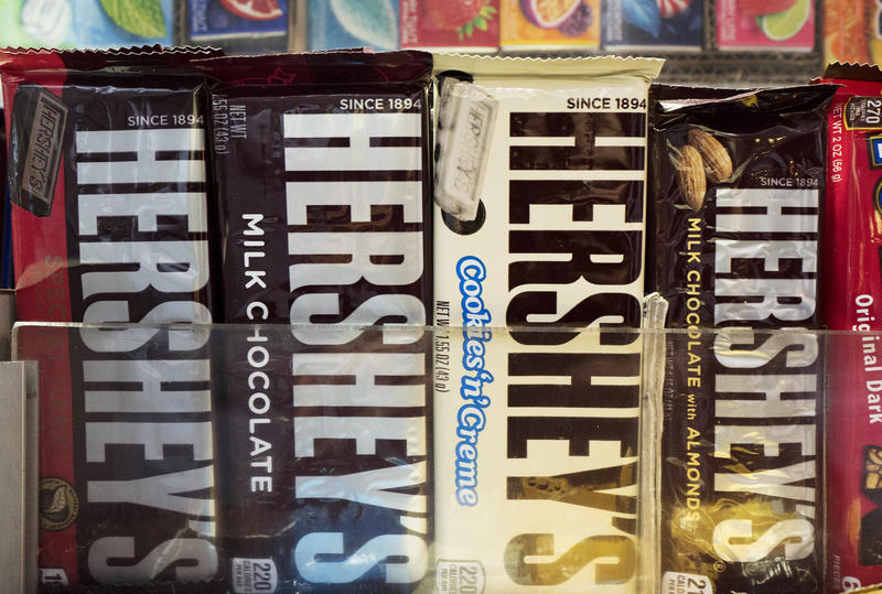 In this Friday, Oct. 7, 2016 photo, Hershey's chocolate bars are displayed on a newsstand in New York.