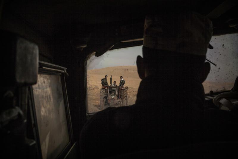 Iraqi soldiers are seen in a tractor from a Humvee while coming back from the frontline in the Al-Intisar district in Mosul, Iraq, Monday, Dec. 5, 2016. Mosul, Iraq's second-largest city, is the last major Islamic State extremist urban bastion in Iraq.