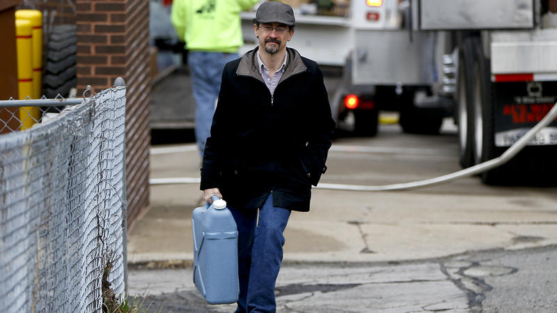 On Feb. 1, 2017, Tim Stuhldeher carried a container of water after filling it at a fire station in Pittsburgh's Lawrenceville neighborhood during the city's flush-and-boil water advisory.