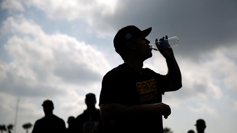 The city of Pittsburgh's water and sewer authority will be restructured in the near future. In this photo from Feb. 14, 2017, Adam Frazier of the Pittsburgh Pirates takes a drink after a spring training workout in Florida.