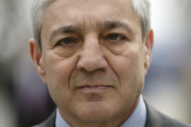 Former Penn State president Graham Spanier walks to the Dauphin County Courthouse in Harrisburg, Pa., Friday, March 24, 2017.