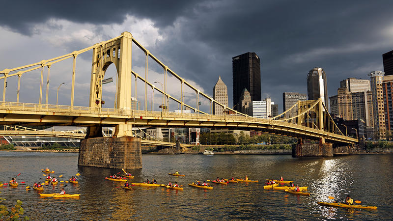 Kayakers paddle past downtown Pittsburgh on the Allegheny River in this September 4, 2015 photo.