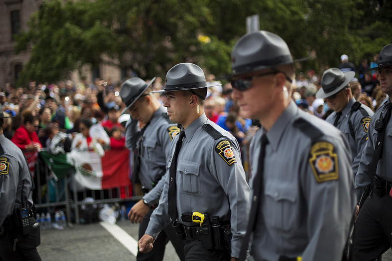 Pennsylvania state police walk up Benjamin Franklin Parkway on Saturday, Sept. 26, 2015 in Philadelphia. A new bill would punish early disclosure of officer's identification after a deady shooting or use of force incident.