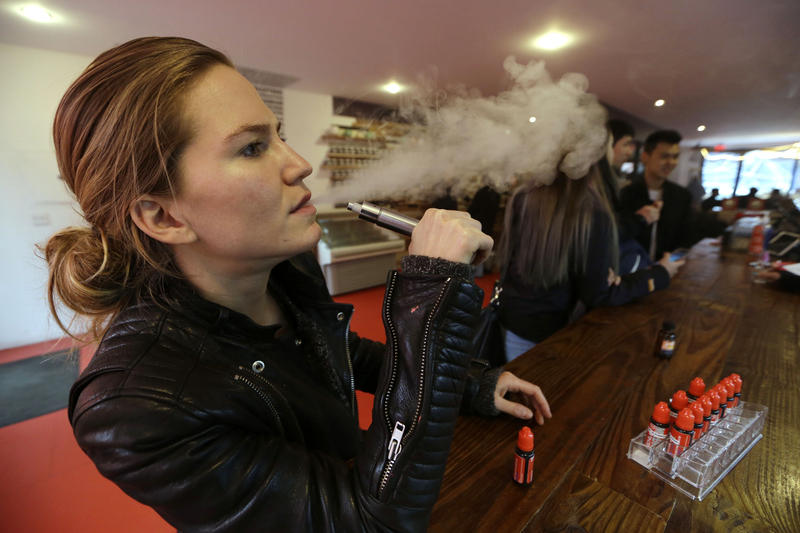 Talia Eisenberg, co-founder of the Henley Vaporium in New York City, uses her vaping device on February 20, 2014.