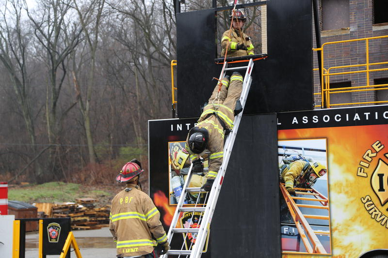 Capt. Joseph Janosko, of Engine 32 in the North Side, demonstrates how to bail out of a fire head-first down a ladder at the fire training facilities along Washington Blvd. on Tuesday, March 28, 2017.