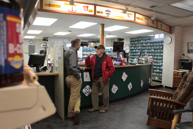 Pharmacist Scott Adamson, left, talks with a customer at McCracken Pharmacy in Waynesburg, Pennsylvania. Like a lot of municipalities in western Pennsylvania, Waynesburg is home to many retired coal miners.