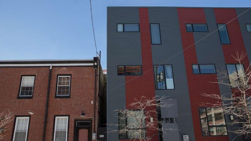 New meets old on Tulip Street in Philadelphia's Fishtown neighborhood where The Nine modern construction is contrasted with an older brick building that's been rehabbed.