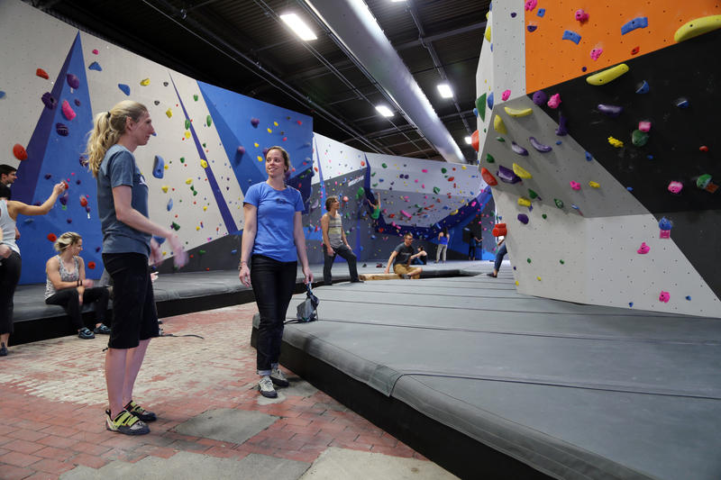 Climbers check out the more than 200 routes at Ascend on Pittsburgh's South Side during their opening night celebration on Wednesday, March 15, 2017.