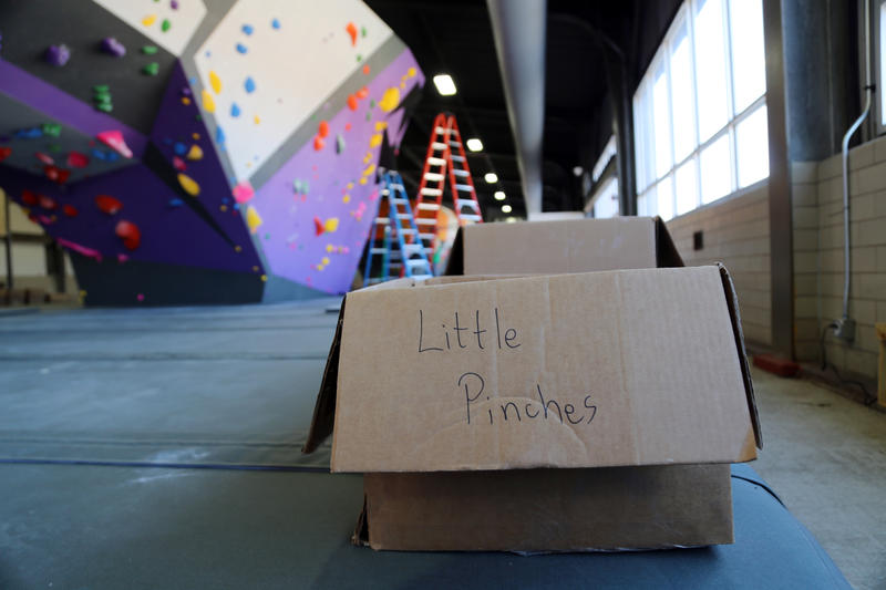 Boxes full of bright, porous climbing holds encircled the boulders at Ascend for days leading up to the gym's opening day. Route setters Brian Pascuzzi and Aaron Gilmore opted for a monochromatic style, meaning routes are color-coded and don't need tape.