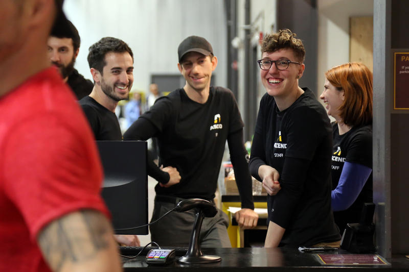 Strength training instructor Sara Middleton (right) greets customers at  Ascend on its opening night, Wednesday, March 15, 2017. Co-owner Paul Guarino, 32, (left) said he expected it would take a few days to get new members inside and orientated.