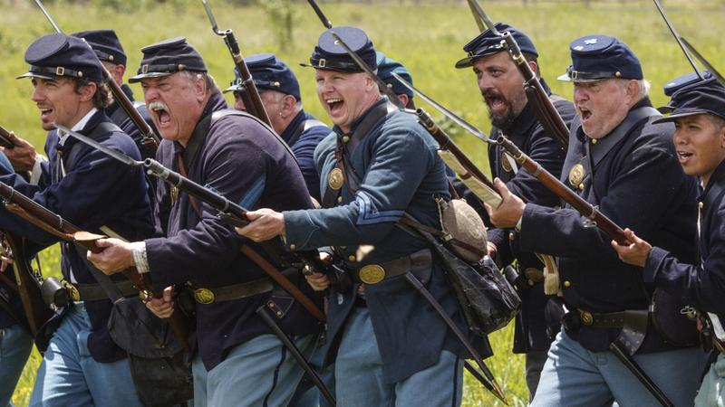 The Mifflin Guard Infantry, volunteer Civil War reenactors, portray Federal soldiers at the battle of Gettysburg on the 153rd anniversary of the Civil War, at Gettysburg National Military Park in Pennsylvania, Saturday, July 2, 2016.