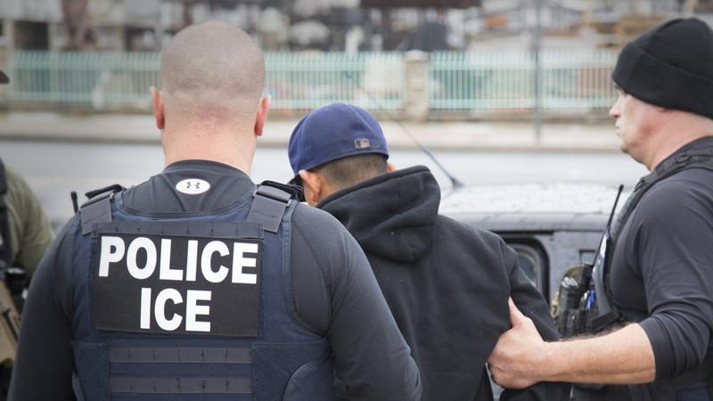 In this Tuesday, Feb. 7, 2017 photo released by U.S. Immigration and Customs Enforcement shows foreign nationals being arrested during a targeted enforcement operation conducted by ICE.