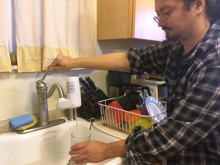 Steve Hayashi of Squirrel Hill fills a glass with filtered water on Monday, March 27, 2017.