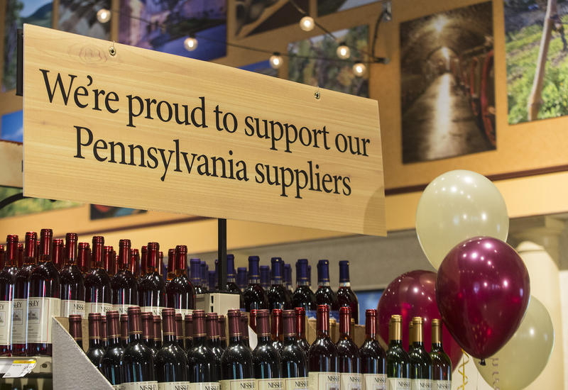 A display holds wine bottles for sale at Wegmans in Mechanicsburg, Pa. Gov. Tom Wolf bought a bottle to celebrate Act 39 liquor reforms.