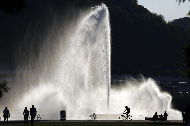 Visitors to Point State Park are silhouetted against a fountain at the confluence of the Monongahela, Allegheny and Ohio rivers in downtown Pittsburgh on Sunday, May 8, 2016.