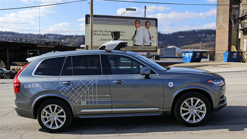 One of Uber's self-driving cars rolls through Pittsburgh on March 17, 2017. The company has agreed to pay the state $3.5 million to settle a long-running dispute about its license to operate.