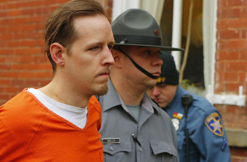Eric Frein is escorted by police out of the Pike County Courthouse after his arraignment in Milfort, Pa., Friday, Oct. 31, 2014.