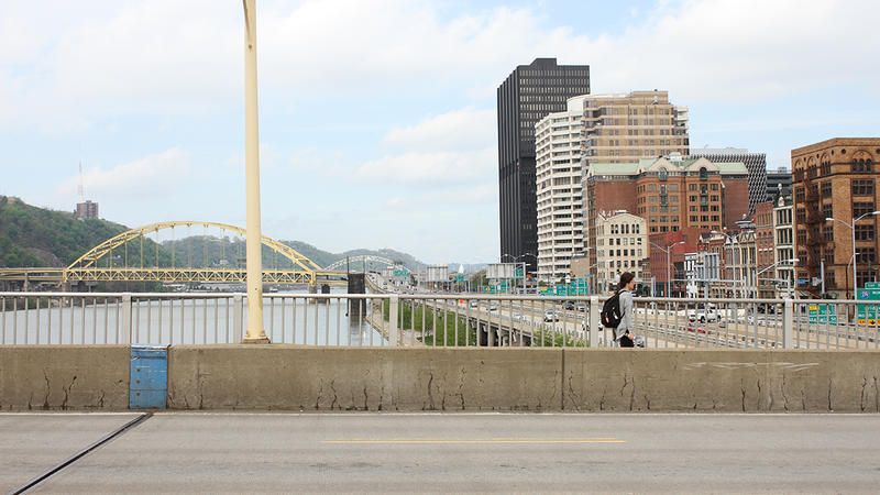 A new ramp will connect the deck of the Smithfield Street Bridge in downtown Pittsburgh with two riverfront trail systems. A long switchback will soften the 40-foot drop between the bridge and the path below.