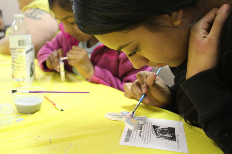 Stephanie Garcia, 17, paints a ceramic butterfly at the Latino Family Center in Hazelwood.