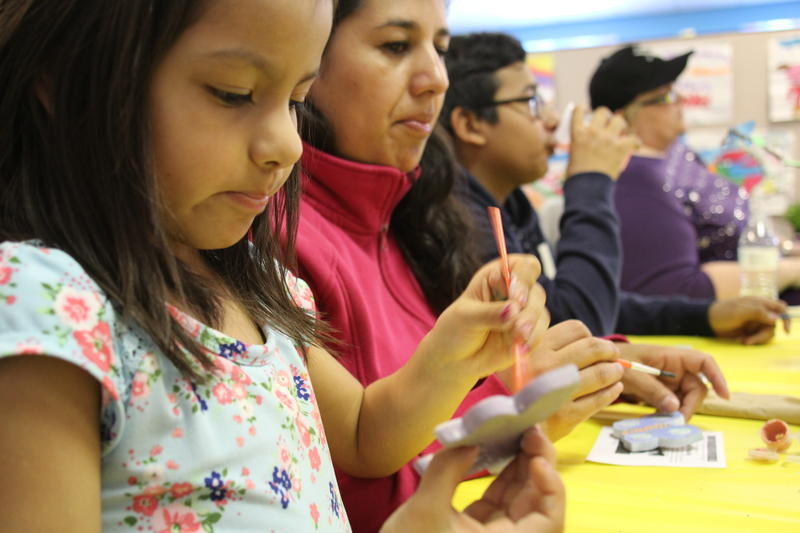 Alondra Garcia, 5, paints a ceramic butterfly Wednesday at the Latino Family Center in Hazelwood.