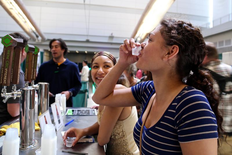 Kenia Guerrero (foreground), 21, of Oakland and Olivia Rivera, 23, of downtown sample soda at the World Medical Cannabis Conference & Expo on April 21, 2017.