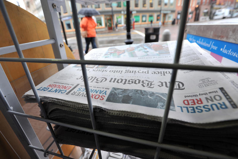 Copies of The Boston Globe on sale at a news stand in Harvard Square in Cambridge, Mass., Wednesday, May 6, 2009.