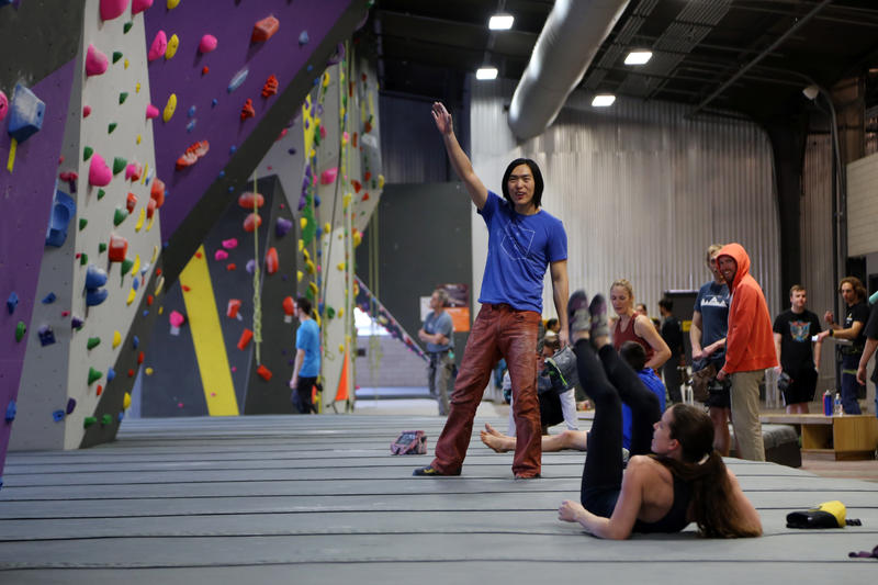 "Zhao Lang, 30, of Bloomfield points to a hold where a fellow climber just slipped off on Wednesday, March 15, 2017. ""This is so amazing,"" he said at Ascend's opening night. ""Everything is my sweet spot tonight."""